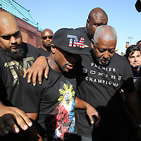 LAS VEGAS, NV - APRIL 14: WBC/WBA welterweight champion Floyd Mayweather Jr. (C) is escorted by members of his security team and advisor Sam Watson (R) as Mayweather arrives at the Mayweather Boxing Club to work out on April 14, 2015 in Las Vegas, Nevada. Mayweather will face WBO welterweight champion Manny Pacquiao in a unification bout on May 2, 2015 in Las Vegas.   (Photo by Alex Menendez/Getty Images) *** Local Caption *** Floyd Mayweather Jr.; Sam Watson