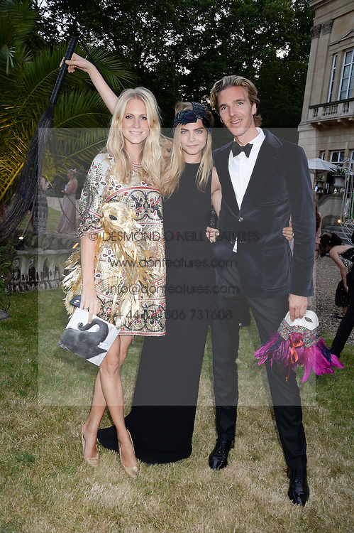 Left to right, POPPY DELEVINGNE, CARA DELEVINGNE and JAMES COOK at The Animal Ball in aid of The Elephant Family held at Lancaster House, London on 9th July 2013.