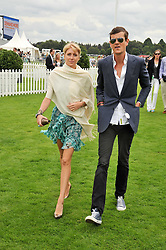 LADY EMILY COMPTON and the HON.ALI SPENCER-CHURCHILL at the 25th annual Cartier International Polo held at Guards Polo Club, Great Windsor Park, Berkshire on 26th July 2009.