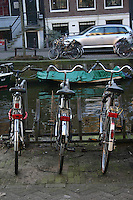 Three bicycles beside the Canal in Amsterdam, the Netherlands<br />