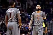 Feb 4, 2016; Phoenix, AZ, USA;  Phoenix Suns center Tyson Chandler (4) talks with teammate forward Markieff Morris (11) during the game against the Houston Rockets at Talking Stick Resort Arena. Mandatory Credit: Jennifer Stewart-USA TODAY Sports