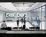 Tim Egan of Honeoye Falls and Jen Bush of Irondequoit assist on a shot during a match at Rochester Curling Club on Sunday, February 8, 2015.