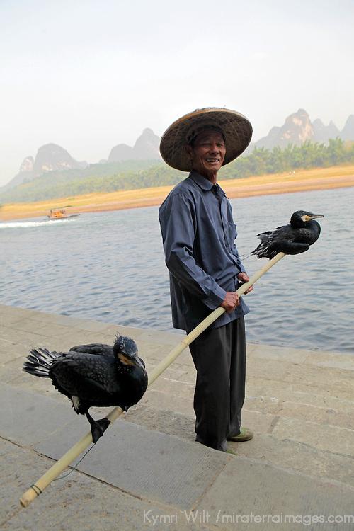 Asia, China, Guilin. Cormorant fisherman on the Li River in China.