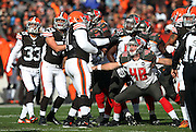 Tampa Bay Buccaneers long snapper Andrew DePaola (48) blocks as players look up to watch the ball on a field goal attempt during the NFL week 9 regular season football game against the Cleveland Browns on Sunday, Nov. 2, 2014 in Cleveland. The Browns won the game 22-17. ©Paul Anthony Spinelli
