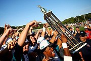 Members of the Brewster Whitecaps celebrate after defeating the Bourne Braves 2-0 to win the Cape Cod League Championship at Stony Brook Field on August 13, 2017 in Brewster, Massachusetts.