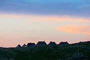 Sylt, Germany. Hörnum. Traditional houses with Reetdächer (reed roofs) at sunset.
