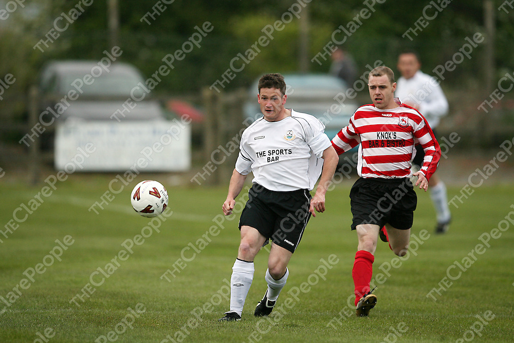 Rineanna's Martin Murphy and Lifford B's Francis Franks chase a loose ball during their cup final clash in the County Grounds on Saturday evening.<br /> Photograph by Yvonne Vaughan