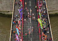 Former Olympic Champion Denise Lewis interviews Paula Radcliffe as she crosses Tower Bridge. The Virgin Money London Marathon, Sunday 26th April 2015.<br /> <br /> Bob Martin for Virgin Money London Marathon<br /> <br /> For more information please contact Penny Dain at pennyd@london-marathon.co.uk