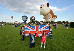 © Licensed to London News Pictures. 04/06/2012. Bristol, UK. Left-right: James Casling age 9, Ollie Beeho age 9, Emma Meacham age 6, Elizabeth Casling age 6, at a party for the people of Bristol on The Downs, with balloons including the Churchill dog. The Royal Jubilee celebrations. Great Britain is celebrating the 60th  anniversary of the countries Monarch HRH Queen Elizabeth II accession to the throne this weekend Photo credit : Simon Chapman/LNP