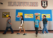 Students at Lyons Elementary school pass by logos for major universities on their way to lunch, April 15, 2013.