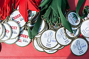 Medals wait to be awarded to participants in the Race for a Reason Triathlon, 5k and Mud Run. Photo by: Ross Brinkerhoff. Race for a Reason, Race 4 A Reason, Annual Events, Events, Students, Faculty & Staff