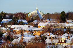 © Licensed to London News Pictures. 13/01/2017<br /> St Barnabas Church in Orpington .<br /> Heavy snow fall overnight in Kent and the South East can be seen this morning on the roof tops of houses with the sun rise.<br /> Photo credit :Grant Falvey/LNP