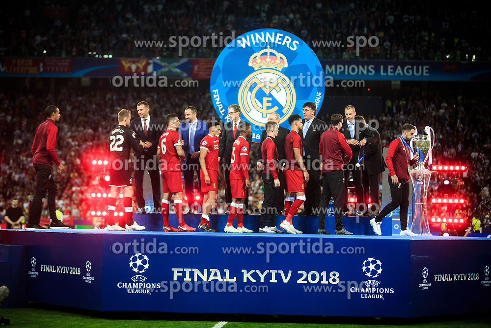 UEFA President Aleksander Ceferin gives players of Liverpool their runners up medals after the UEFA Champions League Final between Real Madrid and Liverpool at NSC Olimpiyskiy Stadium on May 26, 2018 in Kiev, Ukraine. Photo by Sandi Fiser / Sportida