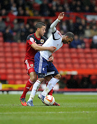 Bristol City's Lewin Nyatanga battles for the ball with Bolton Wanderers' David N'Gog - Photo mandatory by-line: Joe Meredith/JMP - Tel: Mobile: 07966 386802 13/04/2013 - SPORT - FOOTBALL - Ashton Gate - Bristol - Bristol City V Bolton Wanderers - Npower Championship