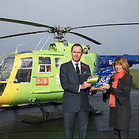 FREE TO USE PHOTOGRAPH....30.10.15<br /> Scotland's Charity Air Ambulance (SCAA) unveiled it's new helicopter at Perth airport this morning a EC135 T2i (pictured) which replaces the Bolkow 105 helicopter which is retiring from service. The new helicopter will increase speed, range, endurance and payload, allow SCAA to fly at night and in cloud. Pictured Helen Page from Clydesdale Bank, and John Bullough Chairman SCAA by the retiring Bolkow 105<br /> for further info please contact Maureen Young on 07778 779000<br /> Picture by Graeme Hart.<br /> Copyright Perthshire Picture Agency<br /> Tel: 01738 623350  Mobile: 07990 594431