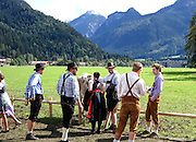In Pfronten, people congratulate one of the participants in this year's viehscheid. Pfronten is located in the Allgau, a region of south central Germany renowned for its agriculture and natural beauty. Alpine peaks lie to the south, over the Austrian border.