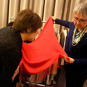 Connie Crow, right shows Eileen Patterson a garment during Starry, Starry Night Friday November 15, 2013 at Cameron Art Museum. (Jason A. Frizzelle)
