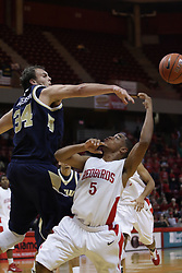 04 December 2010: Anthony Cousin gets whacked by Cody Anderson while taking a one handed shot during an NCAA basketball game between the Montana State Bobcats and the Illinois State Redbirds at Redbird Arena in Normal Illinois.