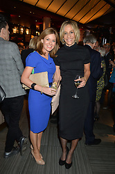 Left to right, ANDREA CATHERWOOD and EMILY MAITLIS at the 2014 Costa Book of The Year Awards held at Quaglino's, Bury Street, London on 27th January 2015.  The winner of the Book of The Year was Helen Macdonald for her book H is for Hawk.