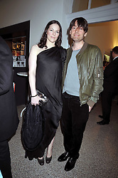 Musician ALEX JAMES and his wife CLAIRE NEAT at a party to celebrate the opening of the new Whitechapel Gallery, 77-82 Whitechapel High Street, London E1 on 2nd April 2009.