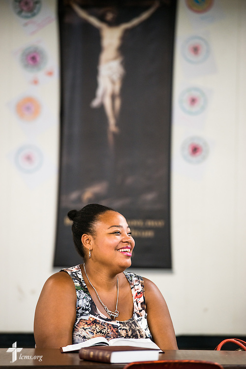 Jasmine White listens to the Rev. Adam DeGroot (not pictured), national missionary pastor at Shepherd of the City Lutheran Church, during bible study on Thursday, Aug. 25, 2016, at the church in Philadelphia. LCMS Communications/Erik M. Lunsford