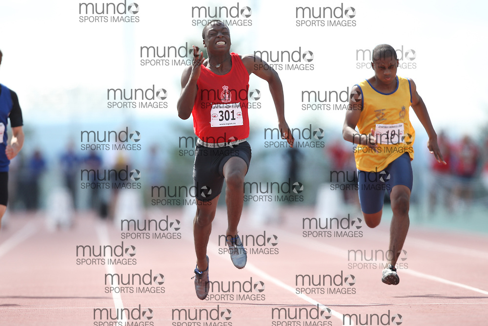 Sherbrooke, Quebec ---08/08/09---  Steven Ajayi of Ontario competes in the 100 metres at the 2009 Legion Canadian Youth Track and Field Championships in Sherbrooke, Quebec, August 10, 2009..HO/ Athletics Canada (credit should read GEOFF ROBINS/Mundo Sport Images/ Athletics Canada)..
