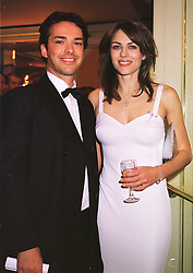 Actress MISS LIZ HURLEY and MR HENRY DENT-BROCKLEHURST, at a ball in London on 13th May 1999.MRZ 75