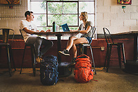 Coffee meeting. Rob Aseltine and Kelly Halpinget down to business inside Sugar House Coffee house, Salt Lake City, Utah.