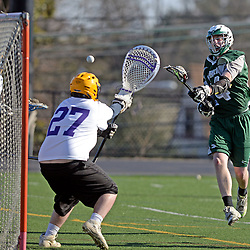 Staff photos by Tom Kelly IV<br /> Bonner-Prendie's Jon Mathis (24) shoots and scores on Upper Darby goalie Casey Kester (27) during the Upper Darby at Bonner-Prendie boys lacrosse game on Monday, March 23, 2015.