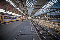 Waiting for the train at Amsterdam Centraal Train Station.