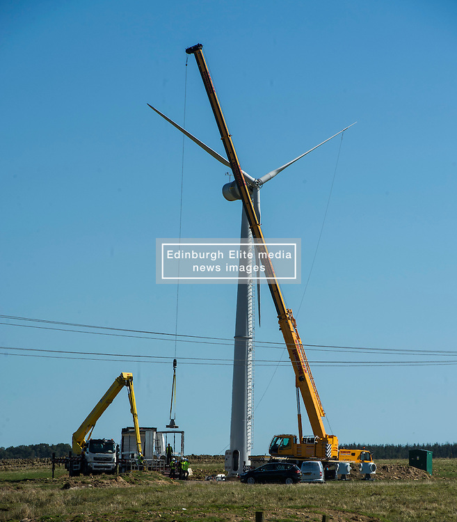 Pictured: Engineers had ideal weather conditions to check the turbine.<br /> <br /> Pomathorn Fam wind turbine was under repair today on the outskirts of Loanstone, near Penicuik Midlothian. The cost to hire the cranes and cherry picker required to reach up to the 16.5 metre turbine blades coming in at around £17,000 per day means that it is not an everyday task.<br /> <br /> Ger Harley   EEm 20 April 2016