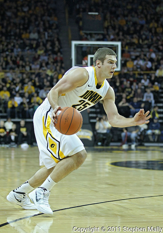 December 28, 2011: Iowa Hawkeyes guard/forward Eric May (25) drives with the ball during the NCAA basketball game between the Purdue Boilermakers and the Iowa Hawkeyes at Carver-Hawkeye Arena in Iowa City, Iowa on Wednesday, December 28, 2011. Purdue defeated Iowa 79-76.