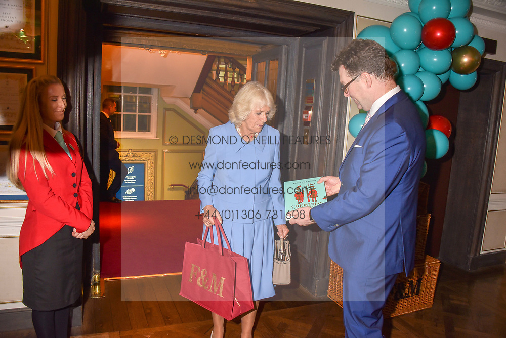 HRH The Duchess of Cornwall and Ewan Venters at the launch of the Fortnum & Mason Christmas & Other Winter Feasts Cook Book by Tom Parker Bowles held at Fortnum & Mason, 181 Piccadilly, London, England. 17 October 2018.
