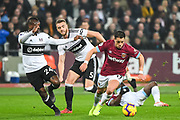 West Ham United Forward Chicharito (17) and Fulham Midfielder Jean Michael Seri (24) in action during the Premier League match between West Ham United and Fulham at the London Stadium, London, England on 22 February 2019.
