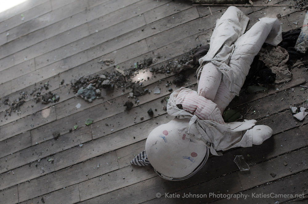 This doll was left behind in a house that was abandoned after a fire.