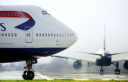 Heathrow Airport, aircraft queued for take off on taxiiway, February 2006, Image Ref CHE03205d, DP