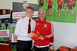 NEWPORT, WALES - Sunday, May 28, 2017: Dan Roberts receives a cap from Elite Performance Director Ian Rush for participation during day three of the Football Association of Wales' National Coaches Conference 2017 at Dragon Park. (Pic by Mark Roberts/Propaganda)