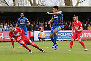 Lyle Taylor forward for AFC Wimbledon (33) shots and scores to make it 1-0 during the Sky Bet League 2 match between AFC Wimbledon and Leyton Orient at the Cherry Red Records Stadium, Kingston, England on 23 April 2016. Photo by Stuart Butcher.