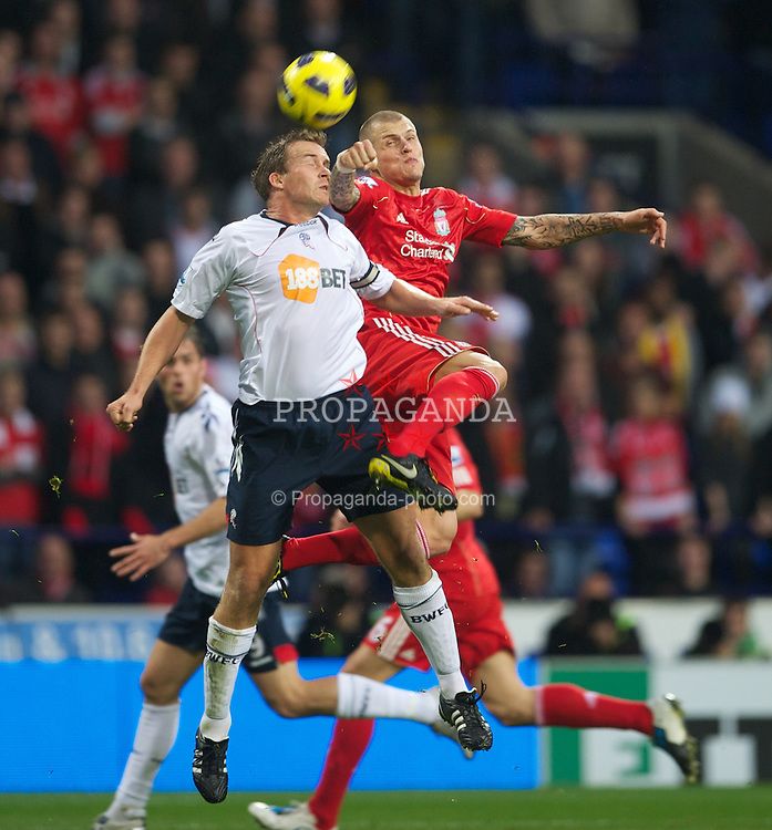 BOLTON, ENGLAND - Sunday, October 31, 2010: Liverpool's Martin Skrtel and Bolton Wanderers' Kevin Davies during the Premiership match at the Reebok Stadium. (Pic by: David Rawcliffe/Propaganda)