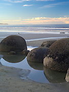 Looking north over the famous Moeraki Boulders (Kaihinaki), Moeraki Beach,  New Zealand.