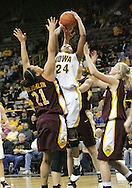 25 JANUARY 2007: Iowa forward Jenee Graham (24) shoots in front of Minnesota forward/center Ashley Ellis-Milan (21) in Iowa's 80-78 overtime loss to Minnesota at Carver-Hawkeye Arena in Iowa City, Iowa on January 25, 2007.