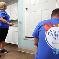 Nina Barnes, a Sherwin Williams employee from the Mall store in Tupelo, helps paint the kitchen area at the Family Resource Center on Tuesday morning in Tupelo.
