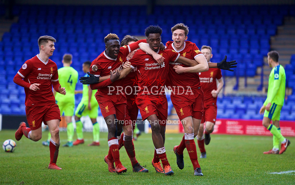 BIRKENHEAD, ENGLAND - Sunday, January 28, 2018: Liverpool's Oviemuno Ovie Ejaria celebrates scoring the winning goal with team-mates Bobby Adekanye and Conor Masterson during the Under-23 FA Premier League 2 Division 1 match between Liverpool and Derby County at Prenton Park. (Pic by David Rawcliffe/Propaganda)