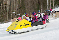 Bianca and Kendall Hutchins lead the pack in their SLE-DOO  during the cardboard sled derby with Laconia Parks and Recreation Thursday afternoon.  (Karen Bobotas/for the Laconia Daily Sun)