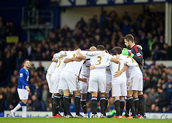 LIVERPOOL, ENGLAND - Sunday, January 24, 2016: Swansea City players form a group huddle before the Premier League match against Everton at Goodison Park. (Pic by David Rawcliffe/Propaganda)
