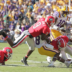 25 October 2008:  Georgia safety Reshad Jones (9) and cornerback Asher Allen (2) close in for a tackle on LSU wide receiver Trindon Holliday (8) during the Georgia Bulldogs 52-38 victory over the LSU Tigers at Tiger Stadium in Baton Rouge, LA.