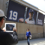 Japanese baseball fans take photographs as they arrive at Yankee Stadium on game day to see Masahiro Tanaka, New York Yankees, pitching during the New York Yankees Vs Tampa Bay Rays, Major League Baseball game at Yankee Stadium, The Bronx, New York. 3rd May 2014. Photo Tim Clayton