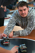 "Mini Sumo. The starting button is released at the ""Go"" command by the referee; five seconds later, the robots start fighting each other..RobotChallenge 2010. First European Robot Sumo Championship..Two robots compete and try to push the competitor off the ring. There are different classes: Standard (3kg), Mini (500g), Micro (100g), Nano (25g) and Humanoid Sumo."