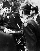 Winston  Leonard Spencer Churchill (1874-1965) British statesman. Churchill, smiling and smoking cigar, shaking hands with a soldier. World War II