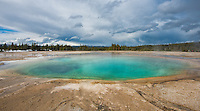 Morning Glory Pool at the Yellowstone National Park Wyoming. Inspired from the shape of a - morning glory flower, this geothermal pool is a result of a super volcano system. These mineral rich waters of the spring surprisingly has active bacteria and other life forms.